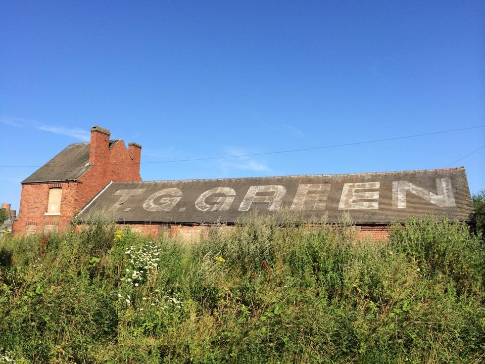 Image of TG Green pottery with roof tiles spelling name of company