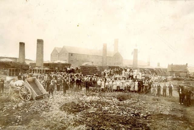 Late 18th centuary photograph of the workforce at Robinson and Dowlers pipe yard.