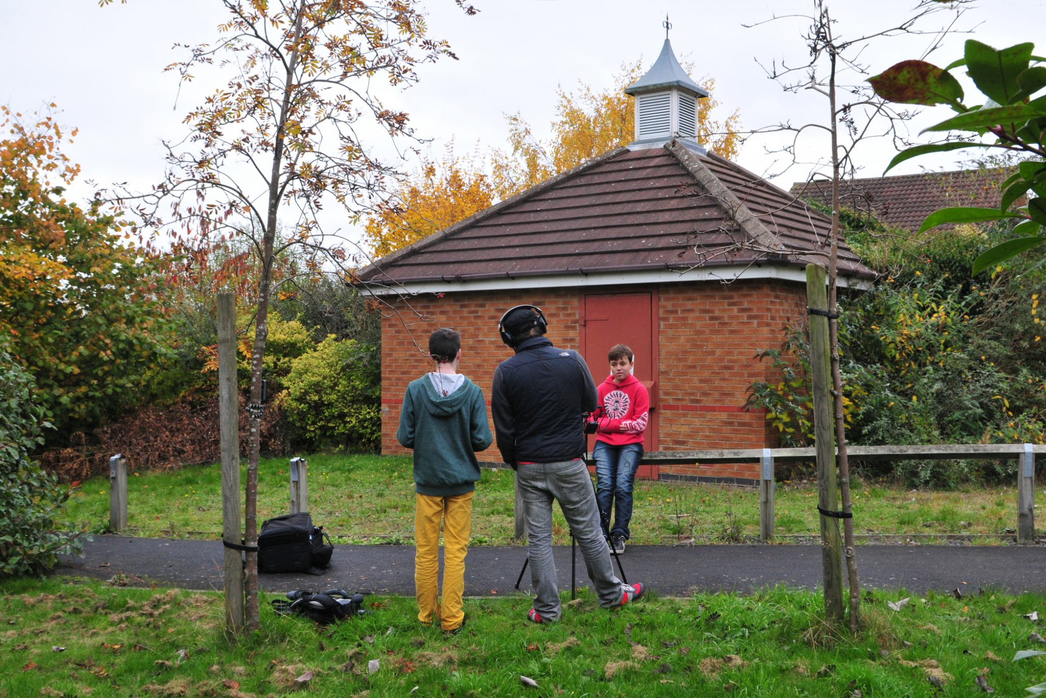 Photo of two people interviewing a young person in Donsithorpe
