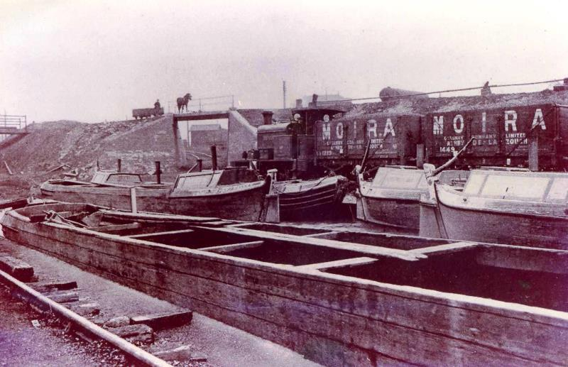 Black and white photograph of Cut End Pit, Overseal, showing barges, steam trams and horse drawn carts