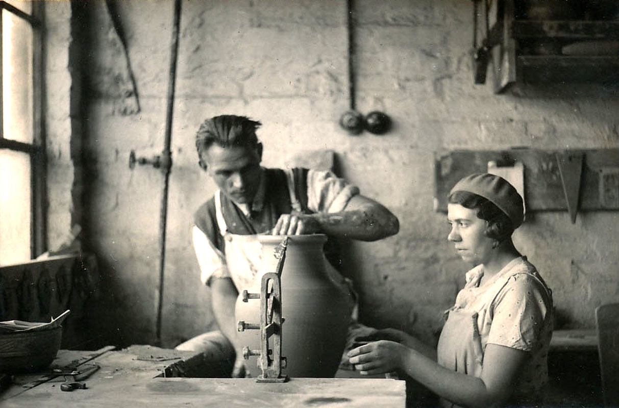 Black and white photo of a pot being measured