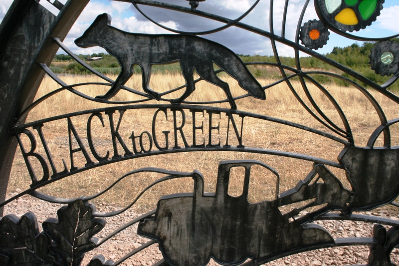 Photo of the detail of Hicks Lodge interpretation hub including Black to Green text and a fox
